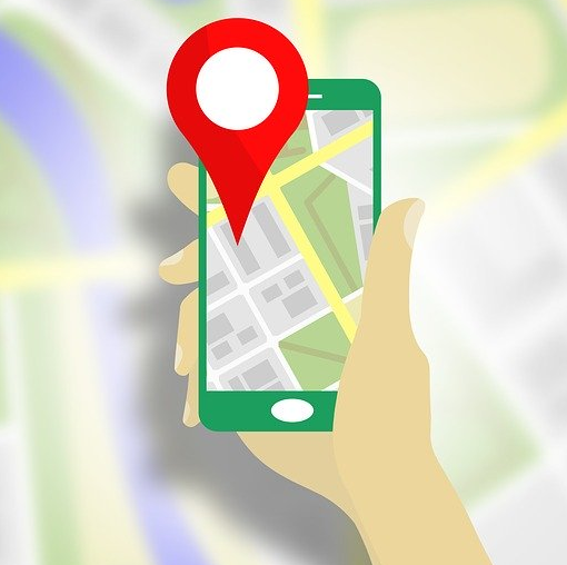 A drawing of a person looking for a location via GPS using a mobile app.